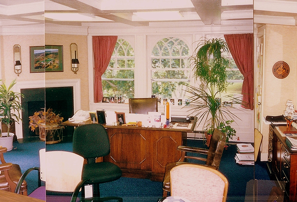 Before:  the headmaster's desk was at the north windows, and the conference table was to the south.