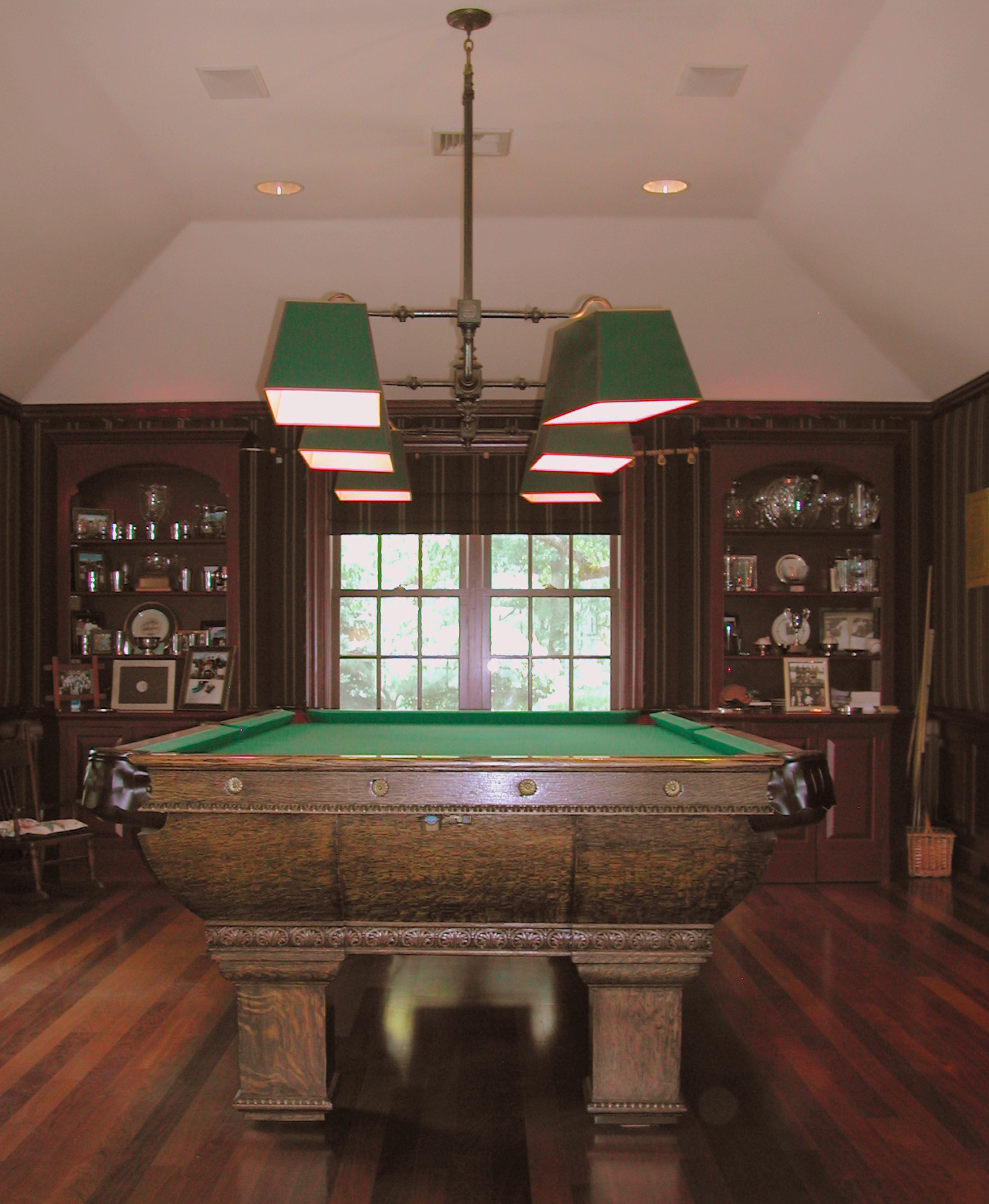The tray ceiling provides a suitable setting for the full-sized pool table, and period lights.