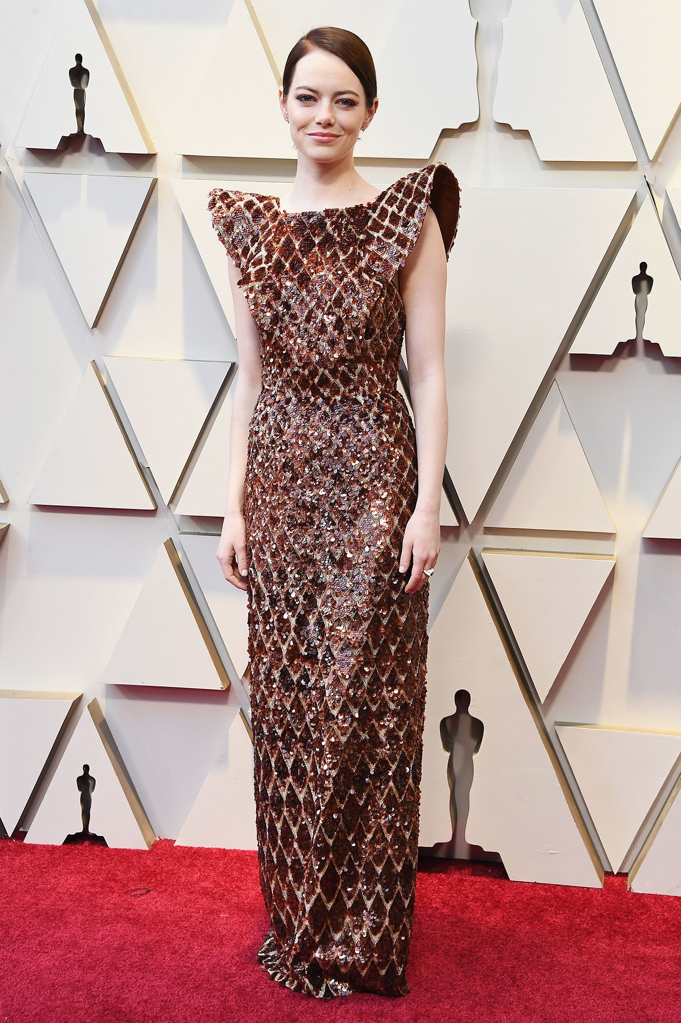 EMMA STONE - LOUIS VUITTON: All elements of this look are perfect. From her hair colour, to the shoulders, to the all over embellishment. On point!
