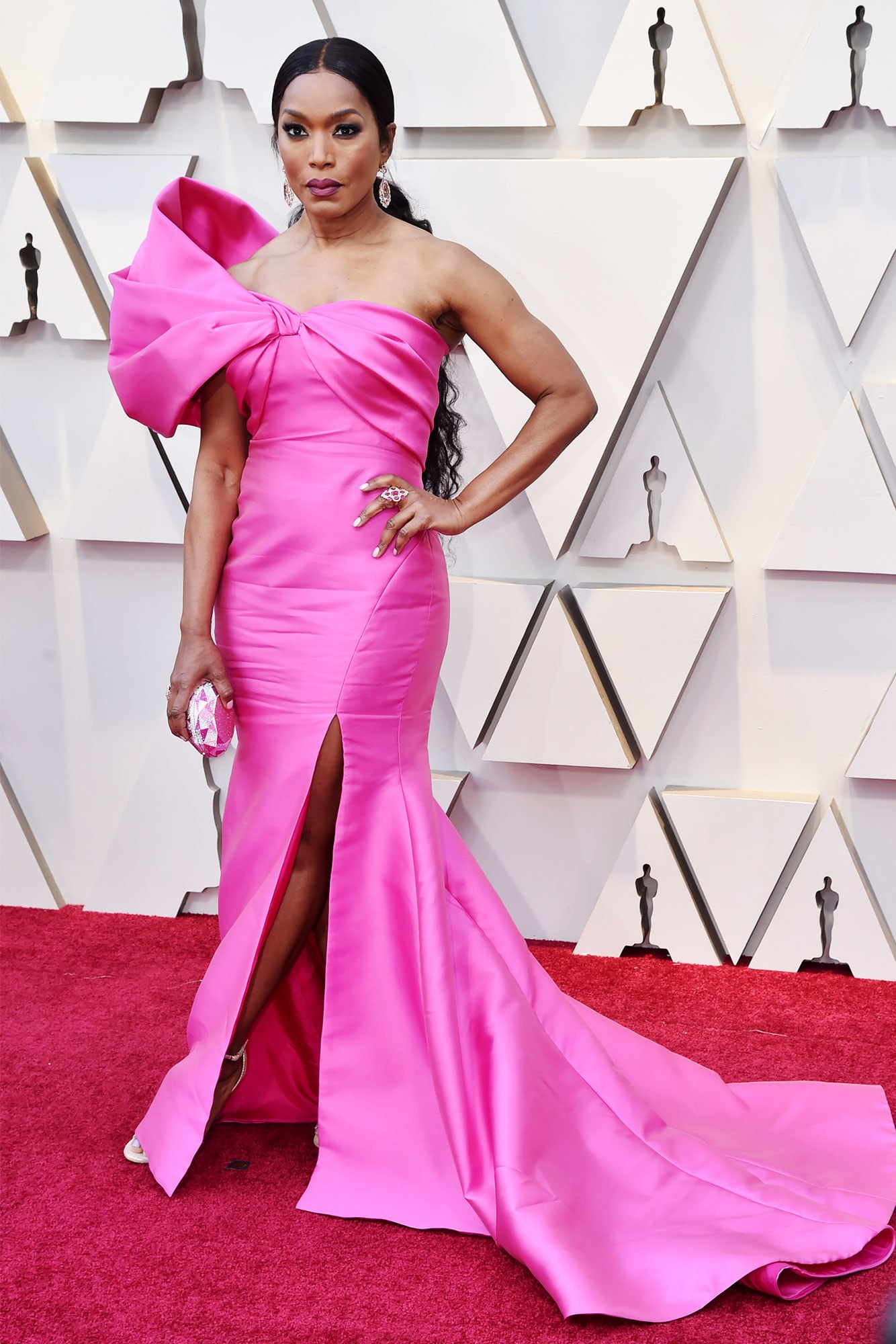 ANGELA BASSETT - REEM ACRA: One of the top colours of the night, hot pink! Loving the bow and the long ponytail.
