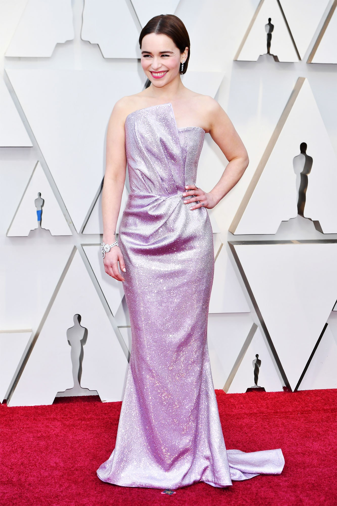 EMILIA CLARKE - BALMAIN: Love everything about this dress; 80s inspo, architectural bodice and the purple/silver effects.