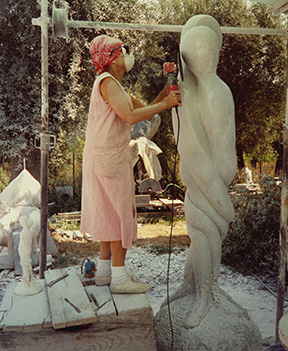 Michele Boyer working on the 8' marble sculpture titled Entwined.