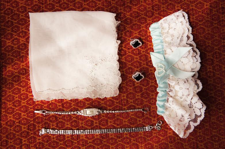 Krystyna's special touches. I'm  loving  vintage hankies lately!    photo courtesy of  Joshua Costes Photography