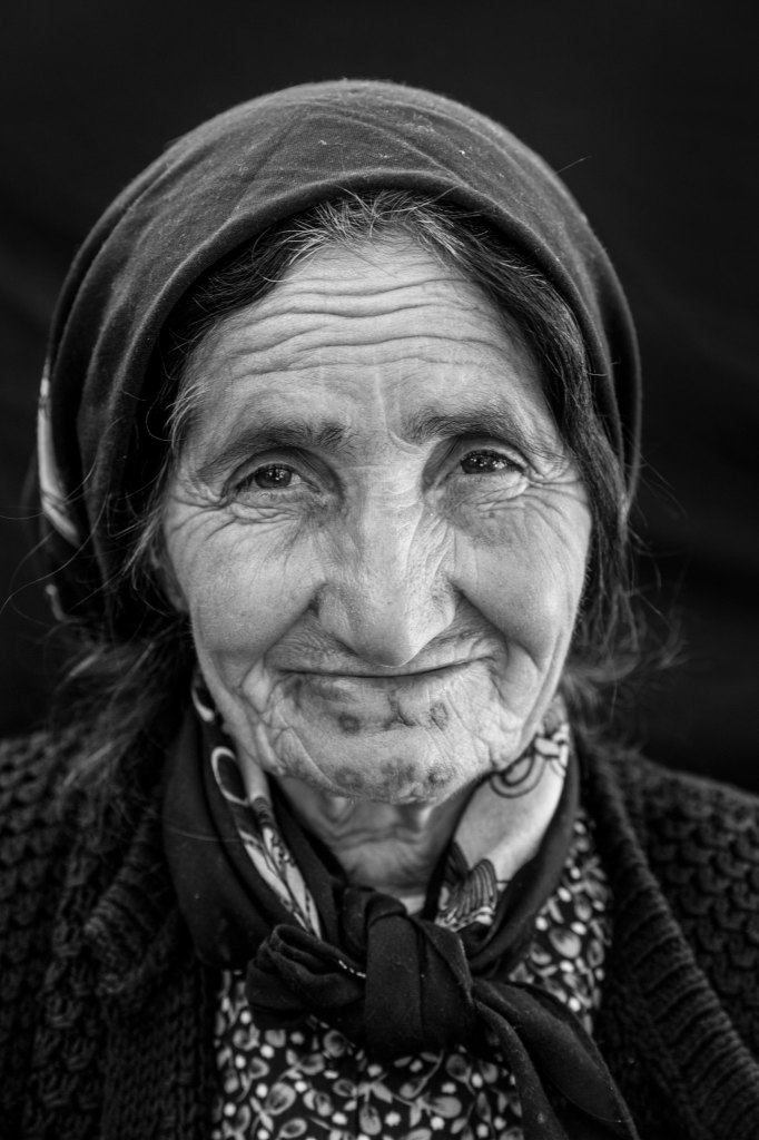 """via National Geographic: Amina Abdel Majid Suleyman, about 70, from Kobane, at Rojava refugee camp in Suruc, Turkey. She is the mother of seven children and cares for two grandchildren whose mother died. """"I was tattooed as a baby, probably when I was about six months old,"""" she says."""