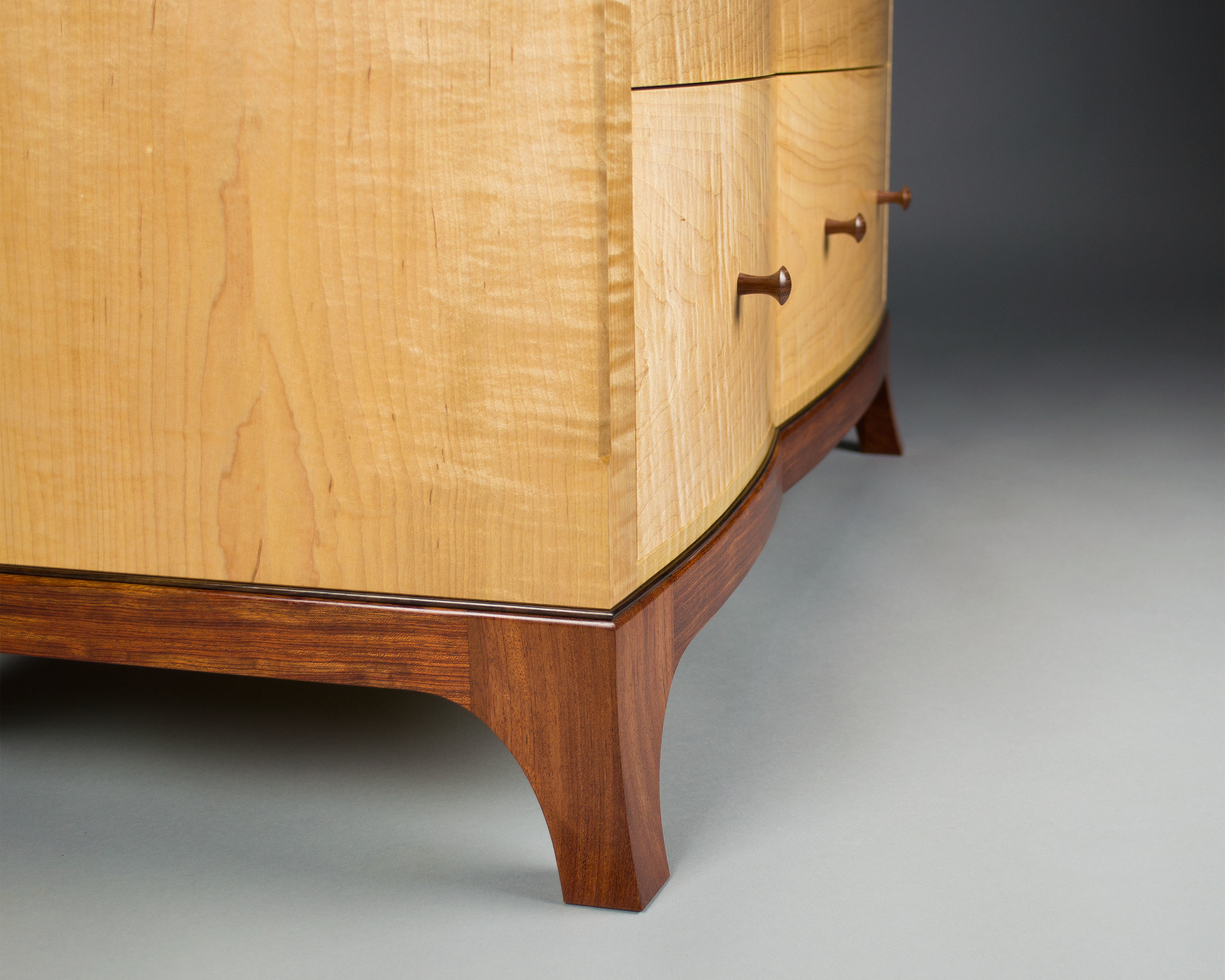 The bubinga and rosewood base is shaped to mirror the curves of the drawer fronts as well.