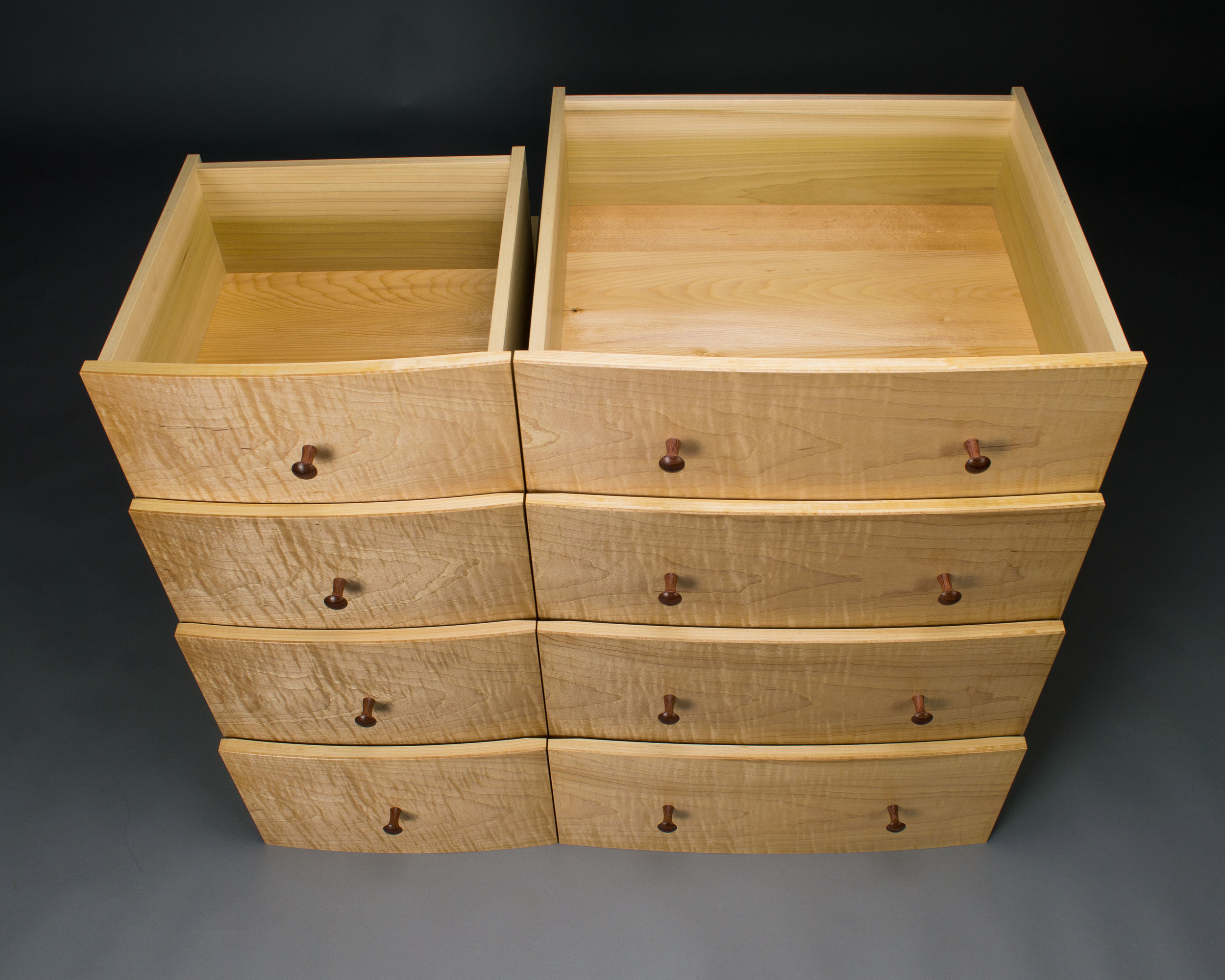 The top left drawer is shortened to make room for the hidden compartment.