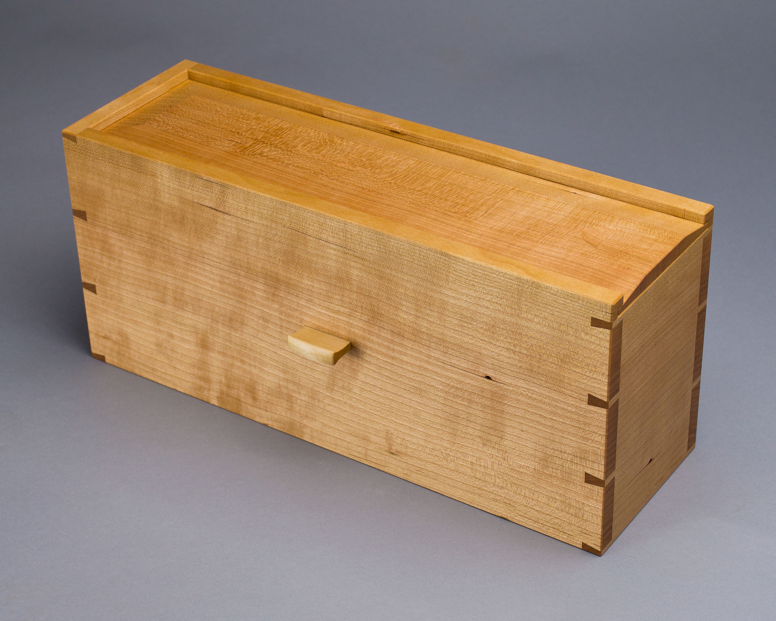 The hidden compartment, a dovetailed box made of quartersawn cherry.