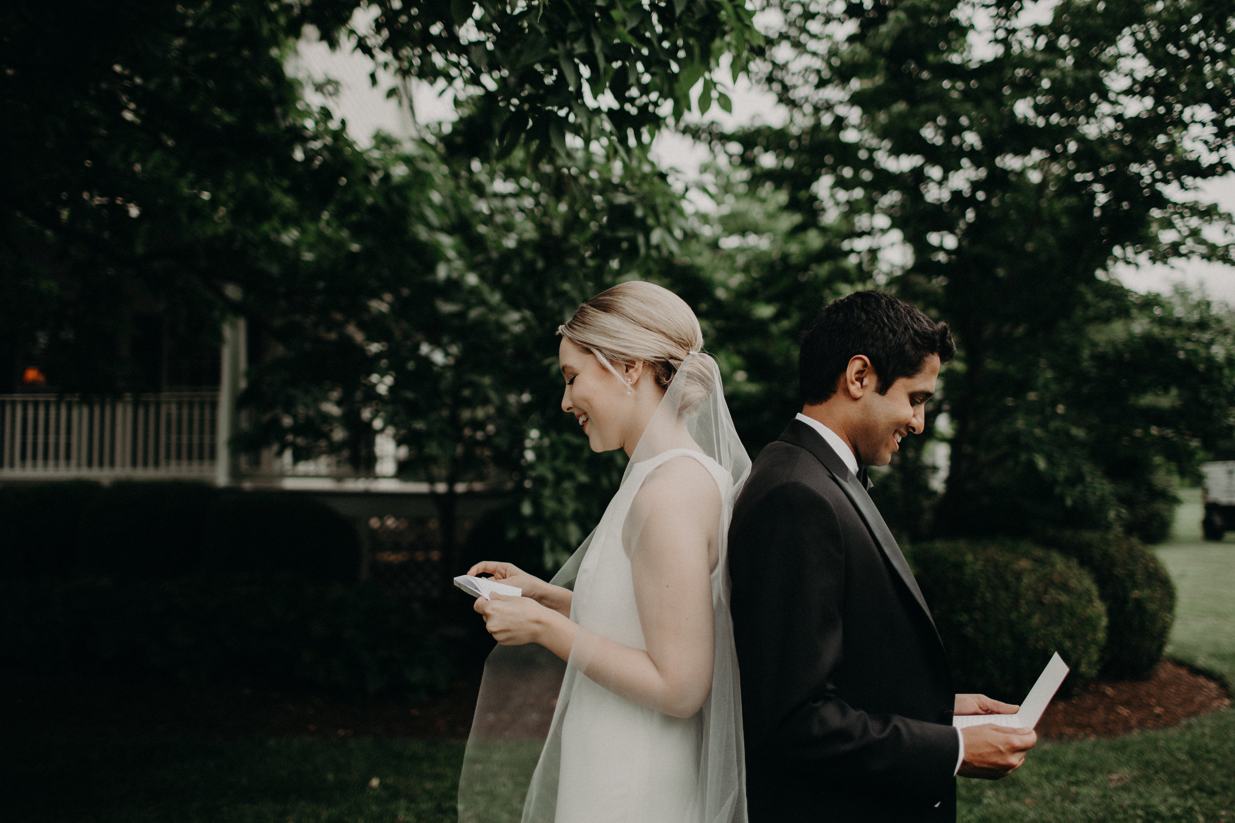 First look for Bride and Groom reading letters