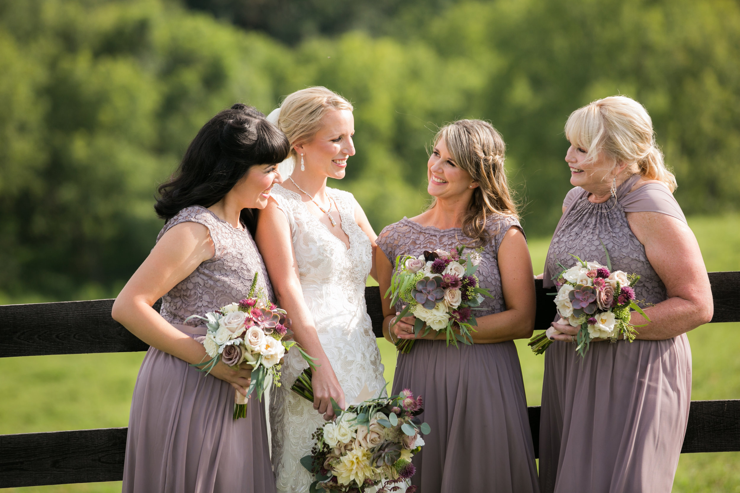 Bride with bridesmaids at Shadow Creek Weddings