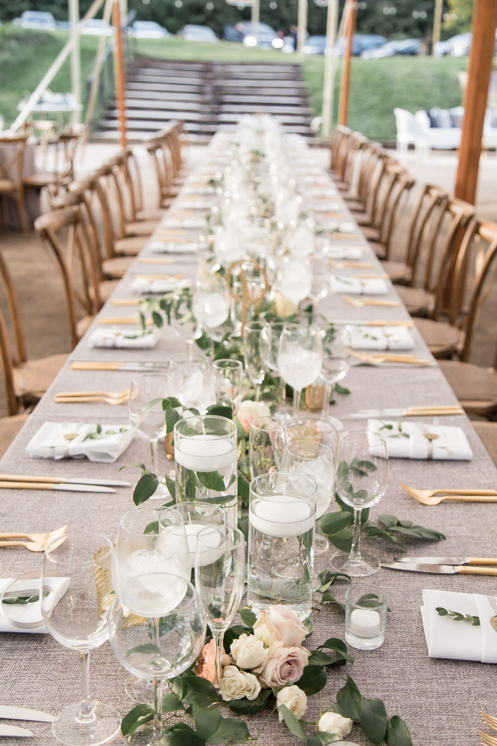 Long table with garland centerpiece at Tranquility Farm
