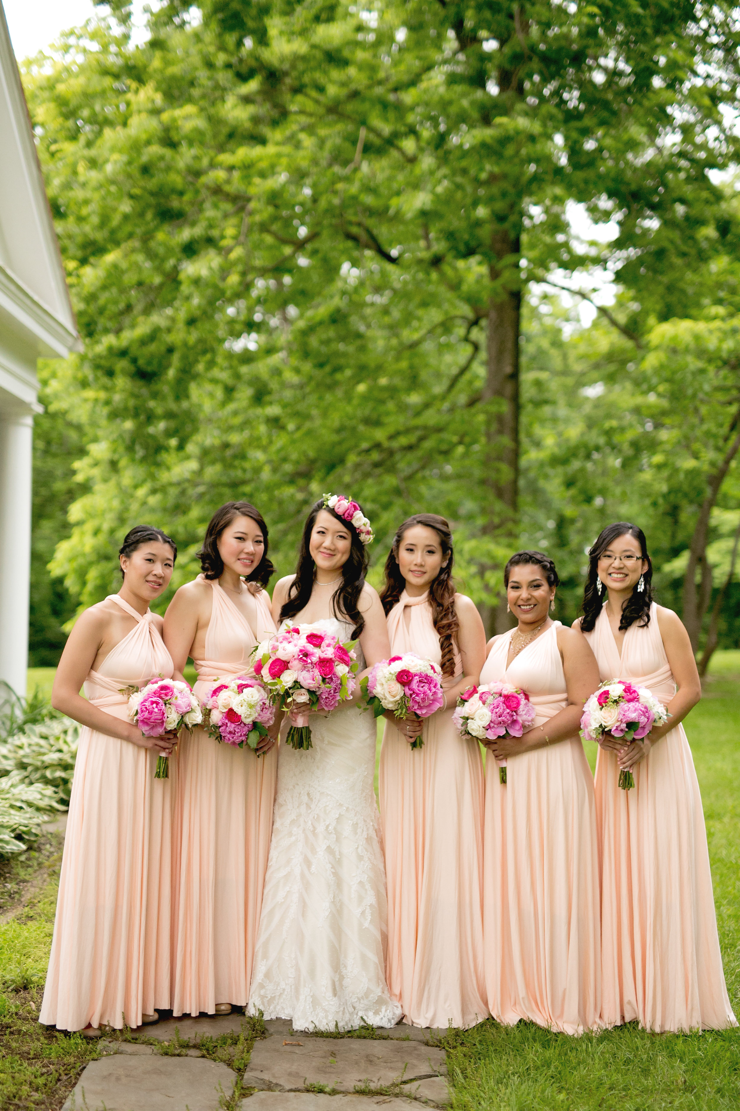 Bridesmaids with blush dresses and pink bouquets