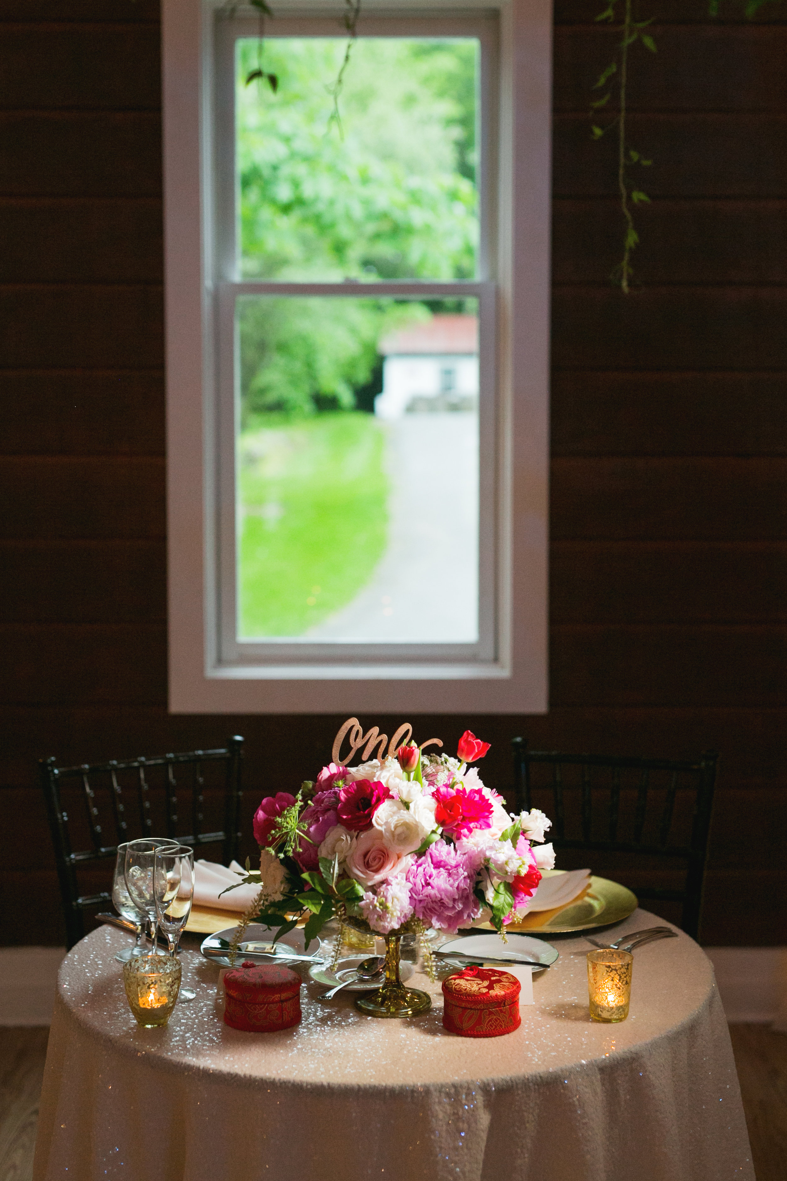 Pink and red wedding flower centerpiece