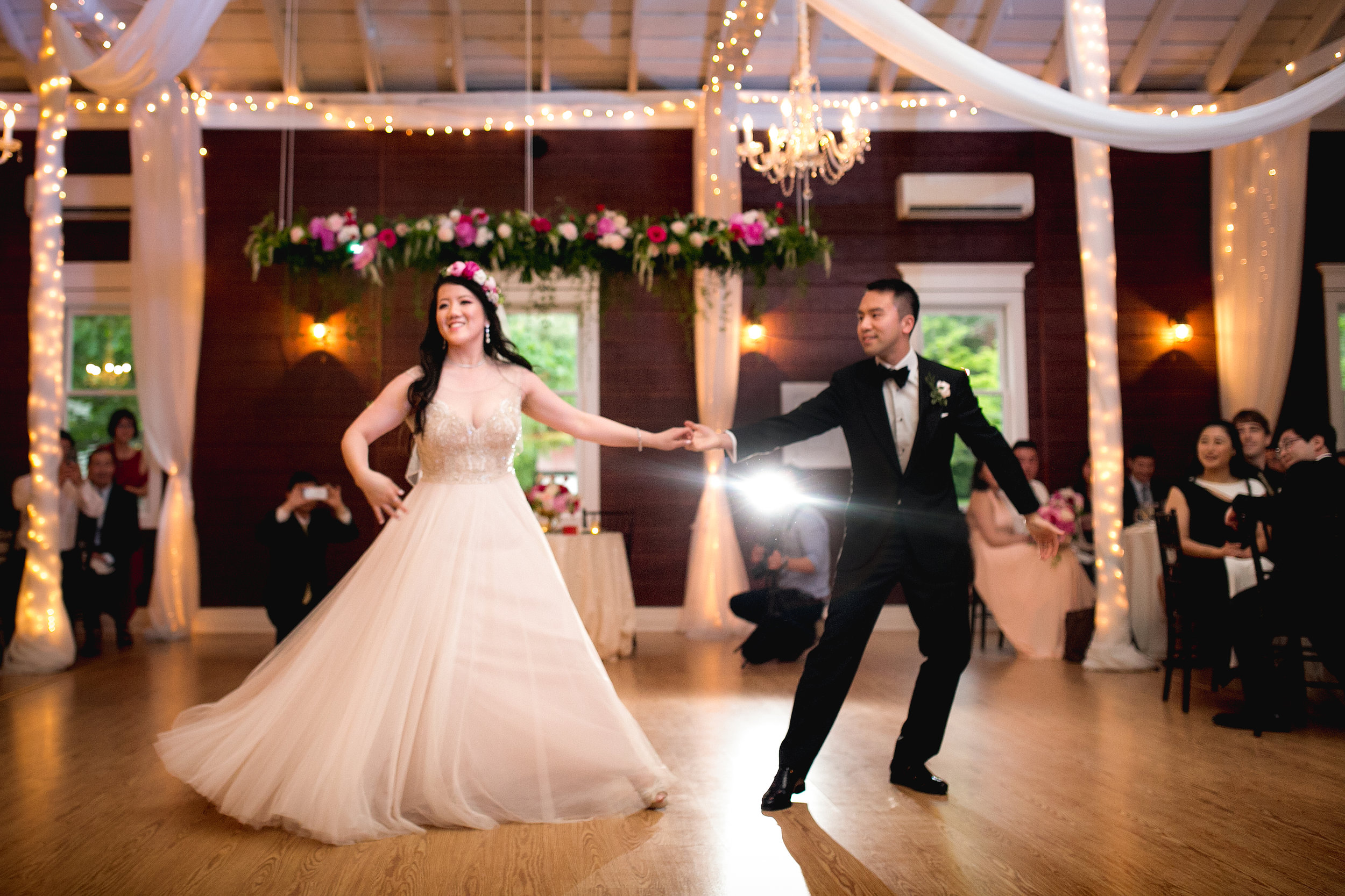 Bride and groom dance at Rosemont Manor. Flowers by Lark Floral