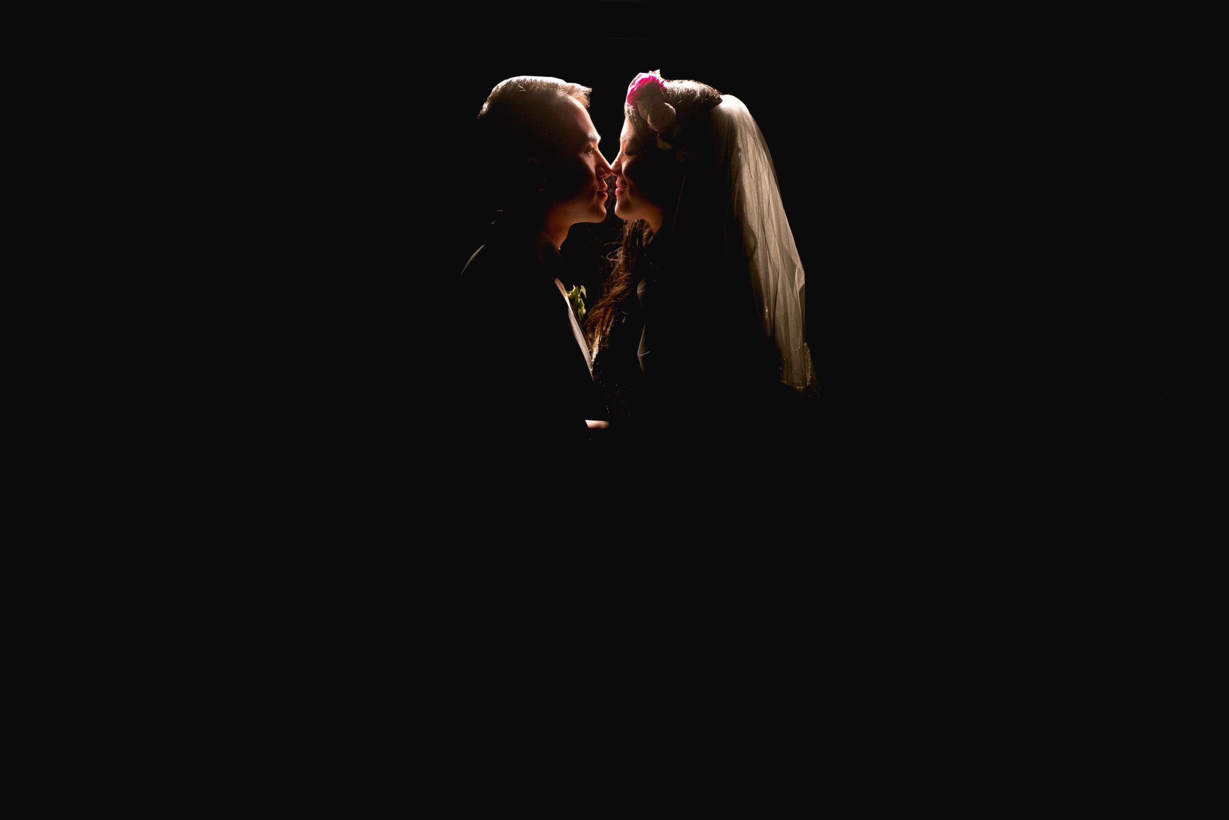 bride and groom silhouette portrait.jpg