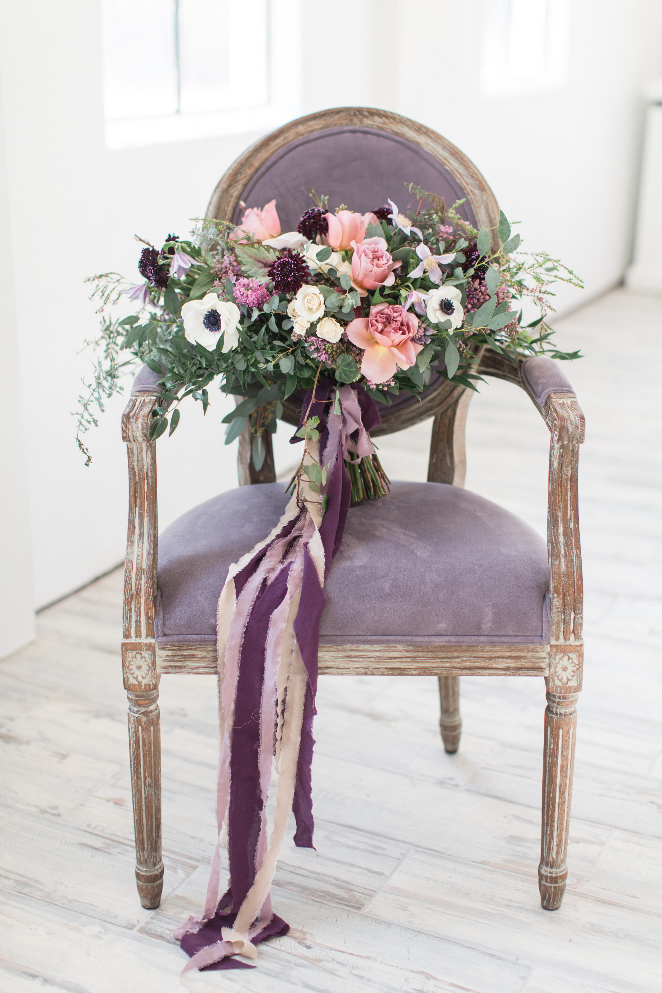 Bridal bouquet of purple and blush pink flowers with silk ribbon by Lark Floral Loudoun County wedding.