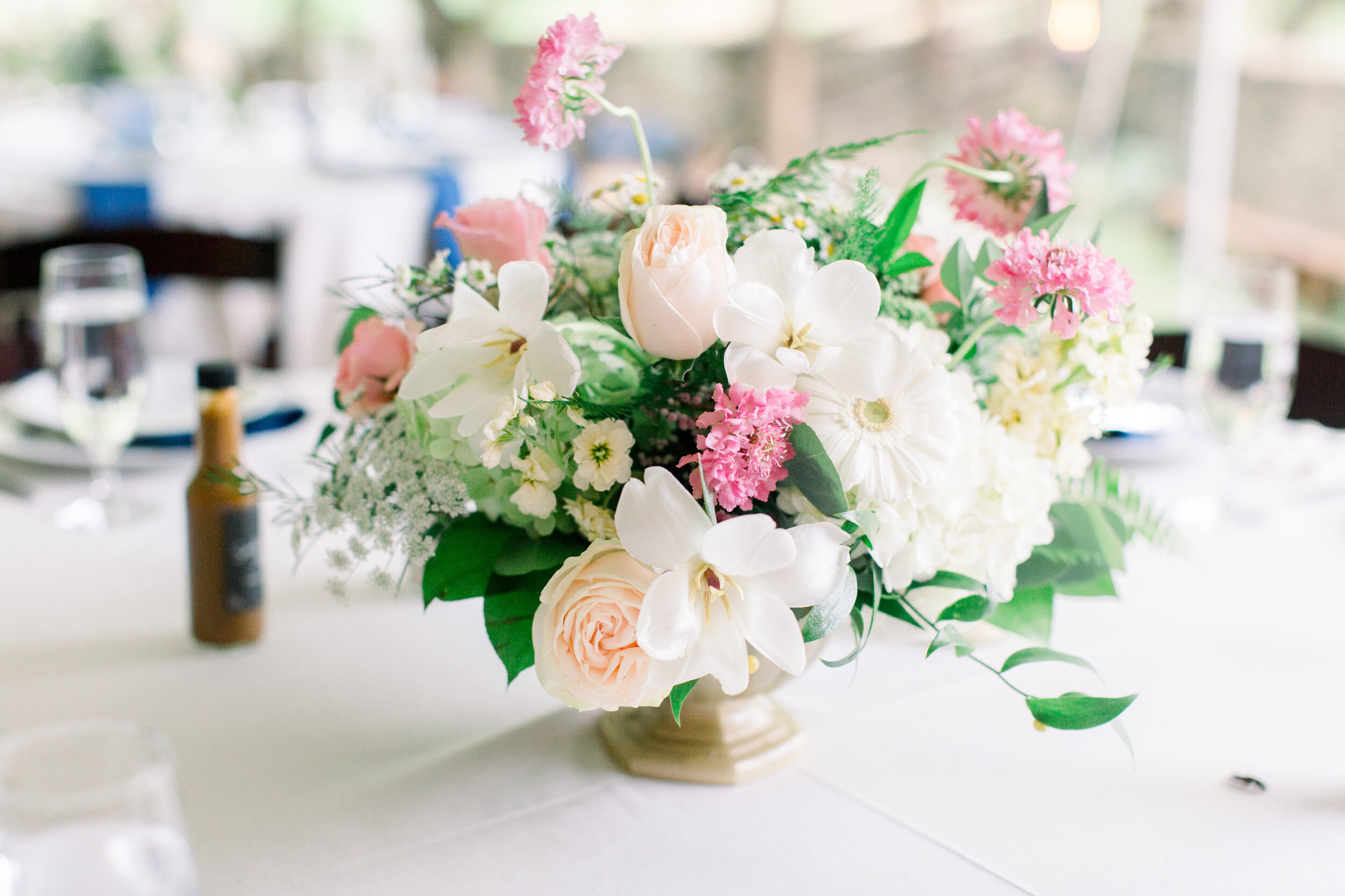 Centerpiece in white, pink, and yellow
