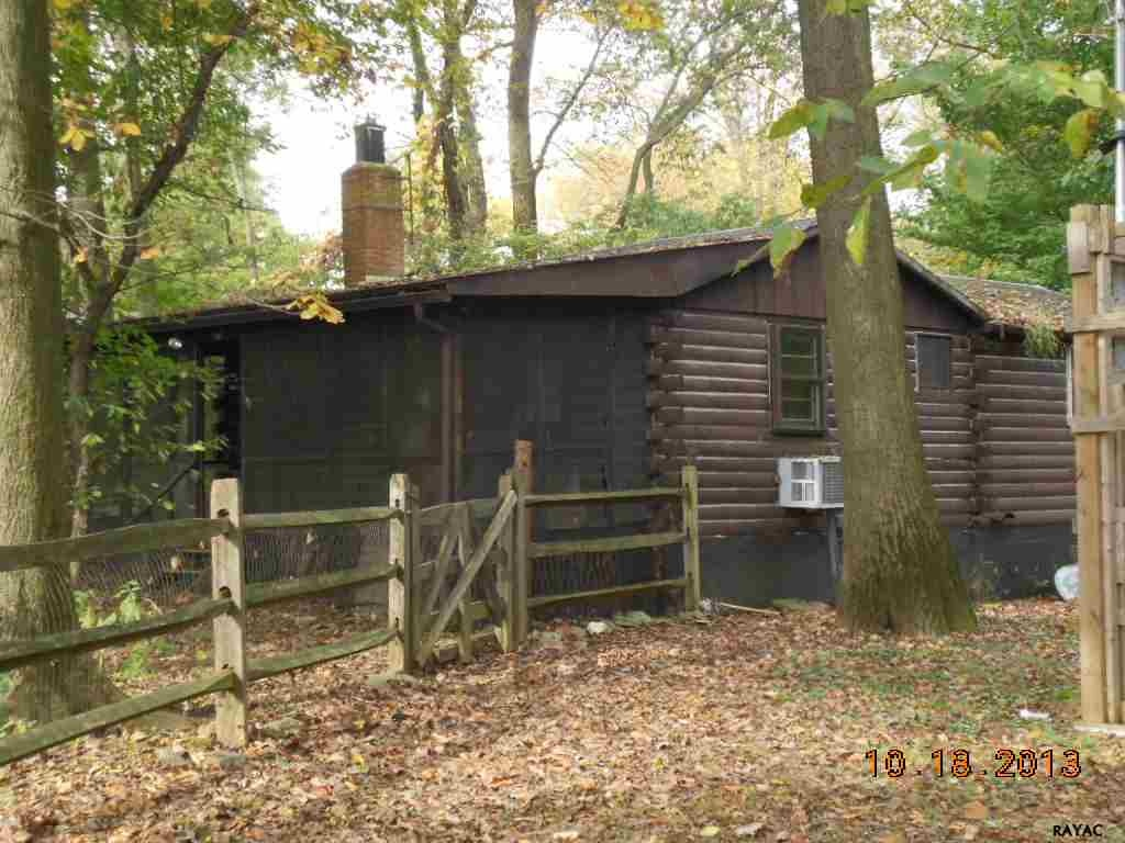 Log Cabin Exterior - Before