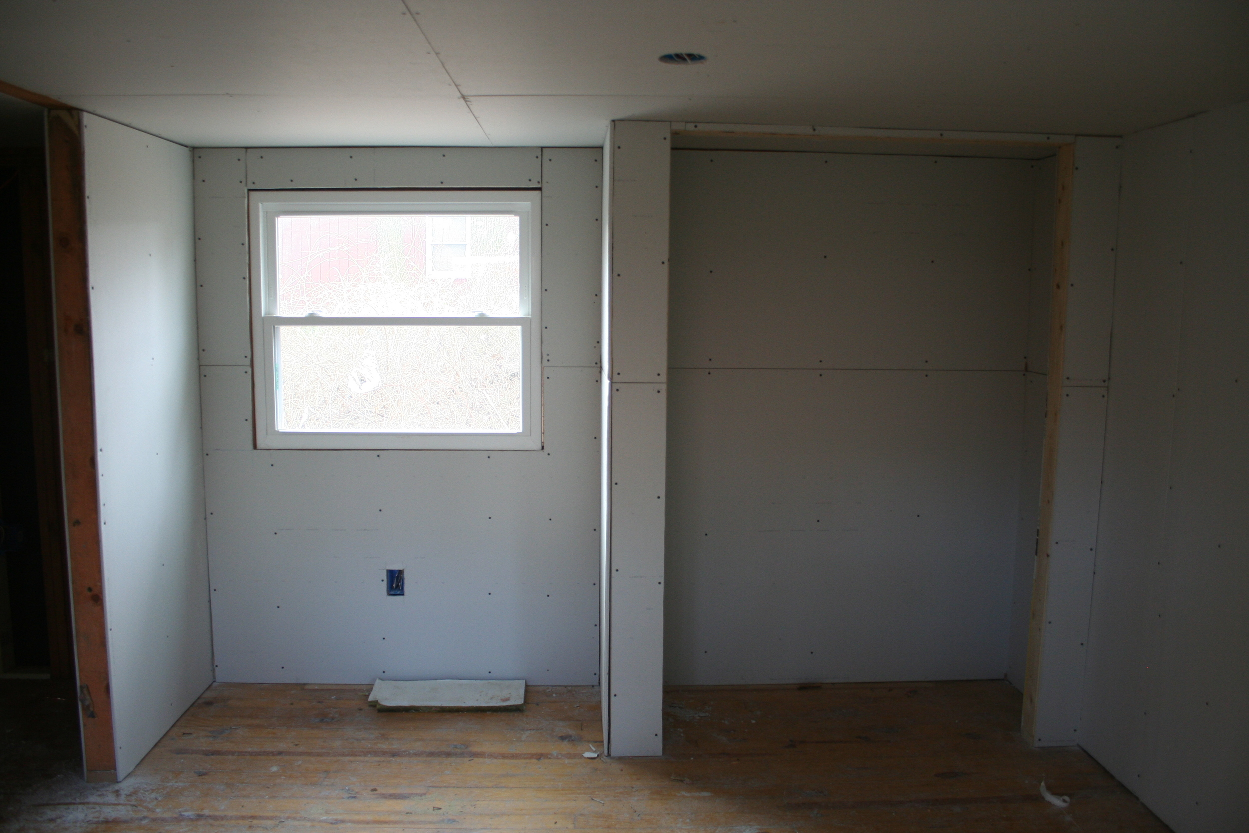 The opposite view, the bedroom as if your back was to the stacks of drywall.