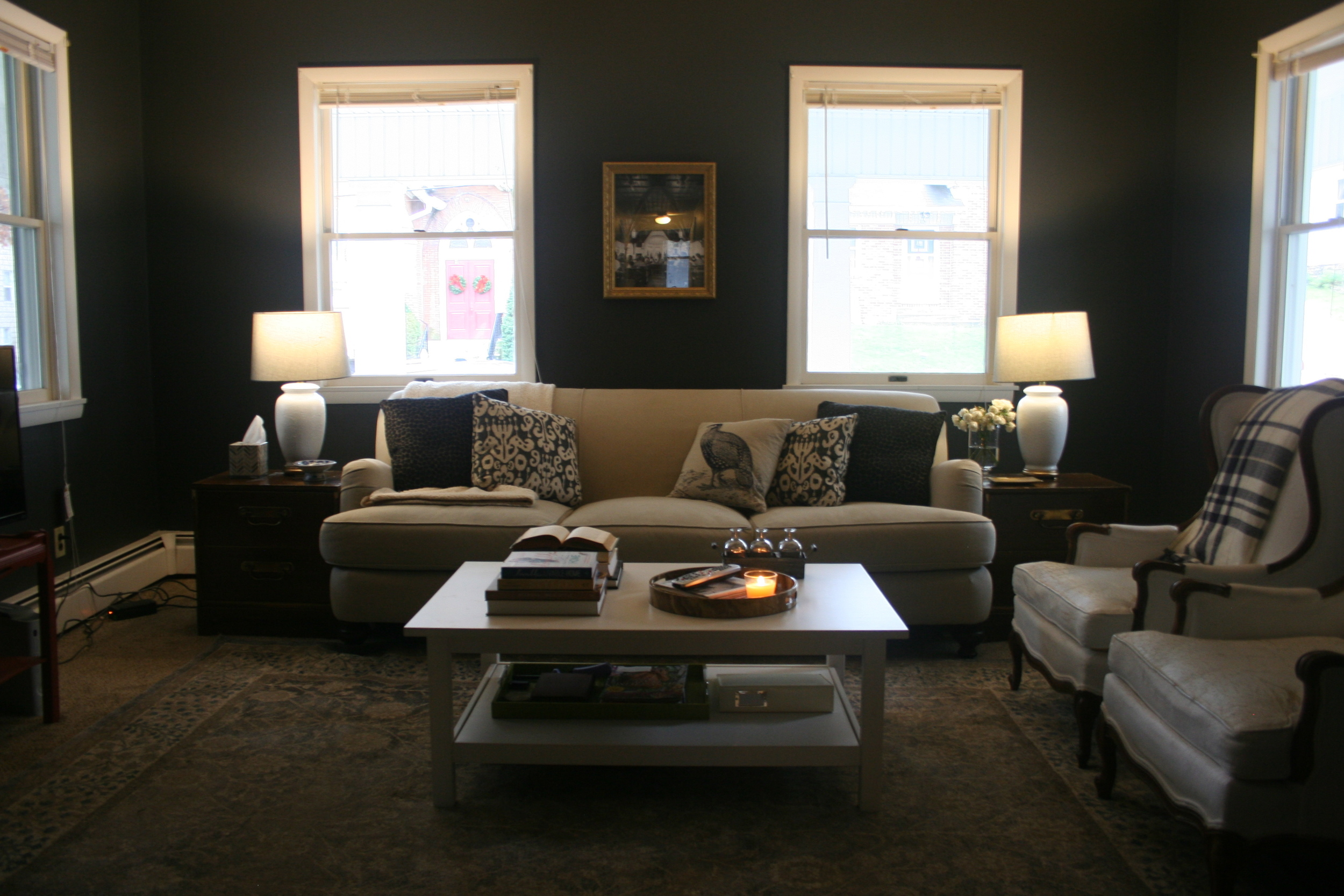 Black, gold and pale blue eclectic country living room by Stevie Storck Design Co.