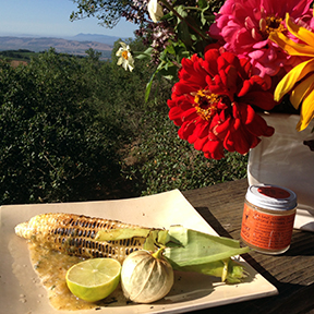 Diana's roasted corn in tomatillo, butter, a squeeze of lime and a sprinkle of Roxy Taco!