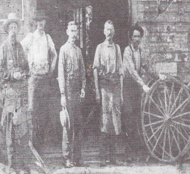T.H.B. Neff (second from the right) in his blacksmith shop in West Virginia, about 1900.
