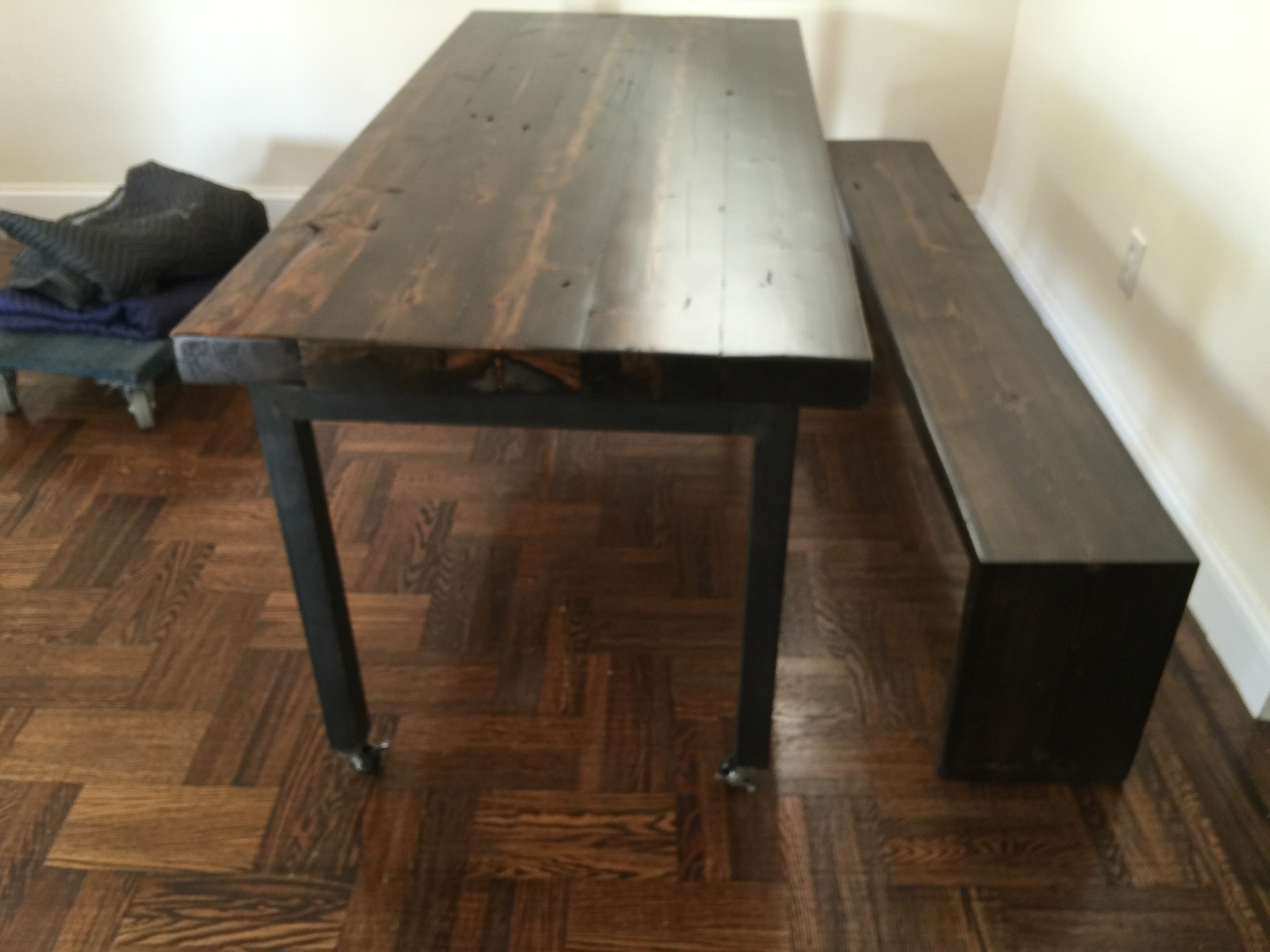 Rustic, ebony-stained table and bench