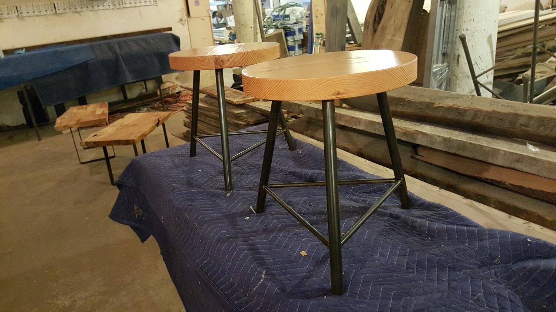 Douglas fir stools three legged bases.