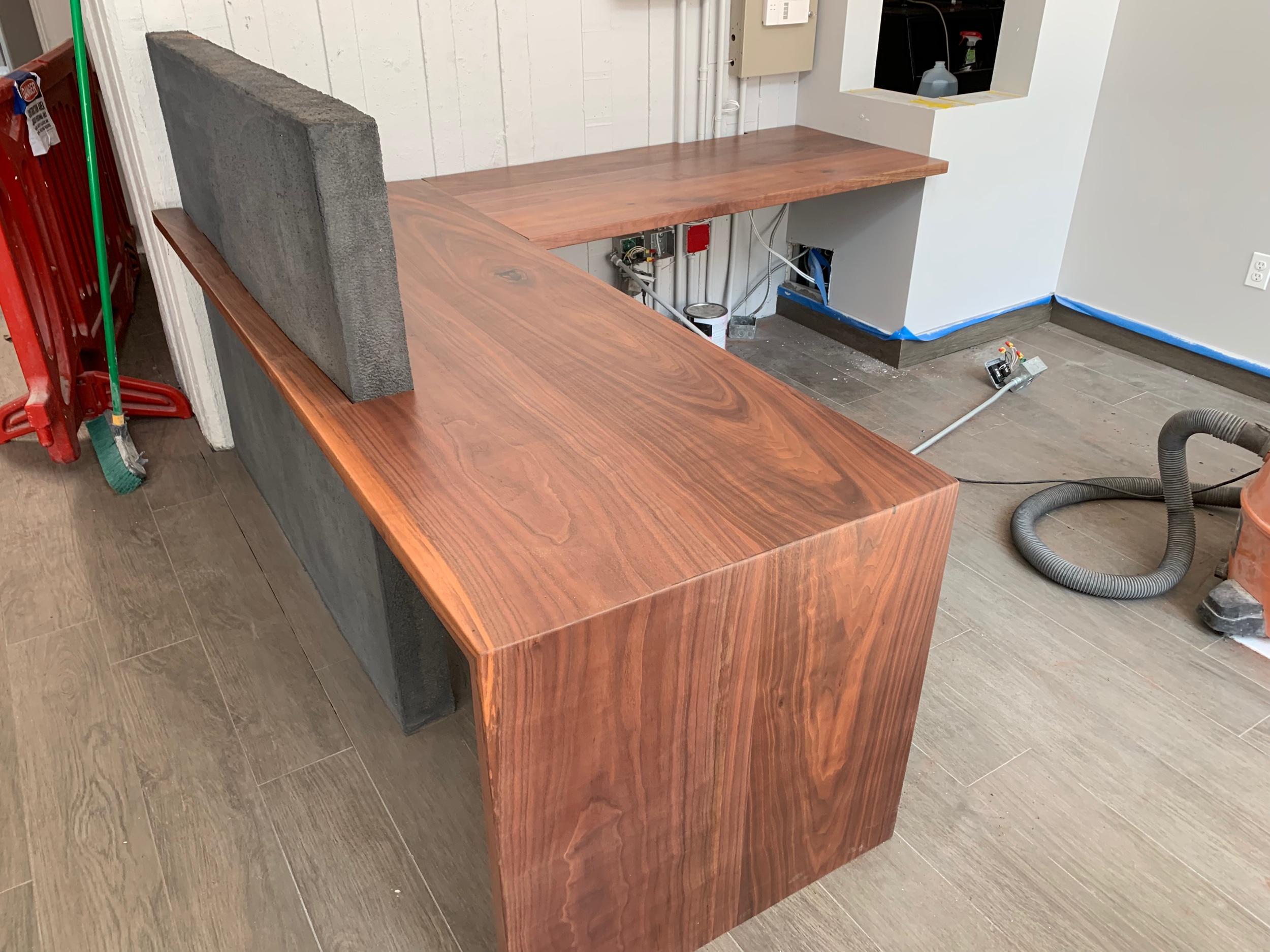 Walnut and concrete counter reception desk.