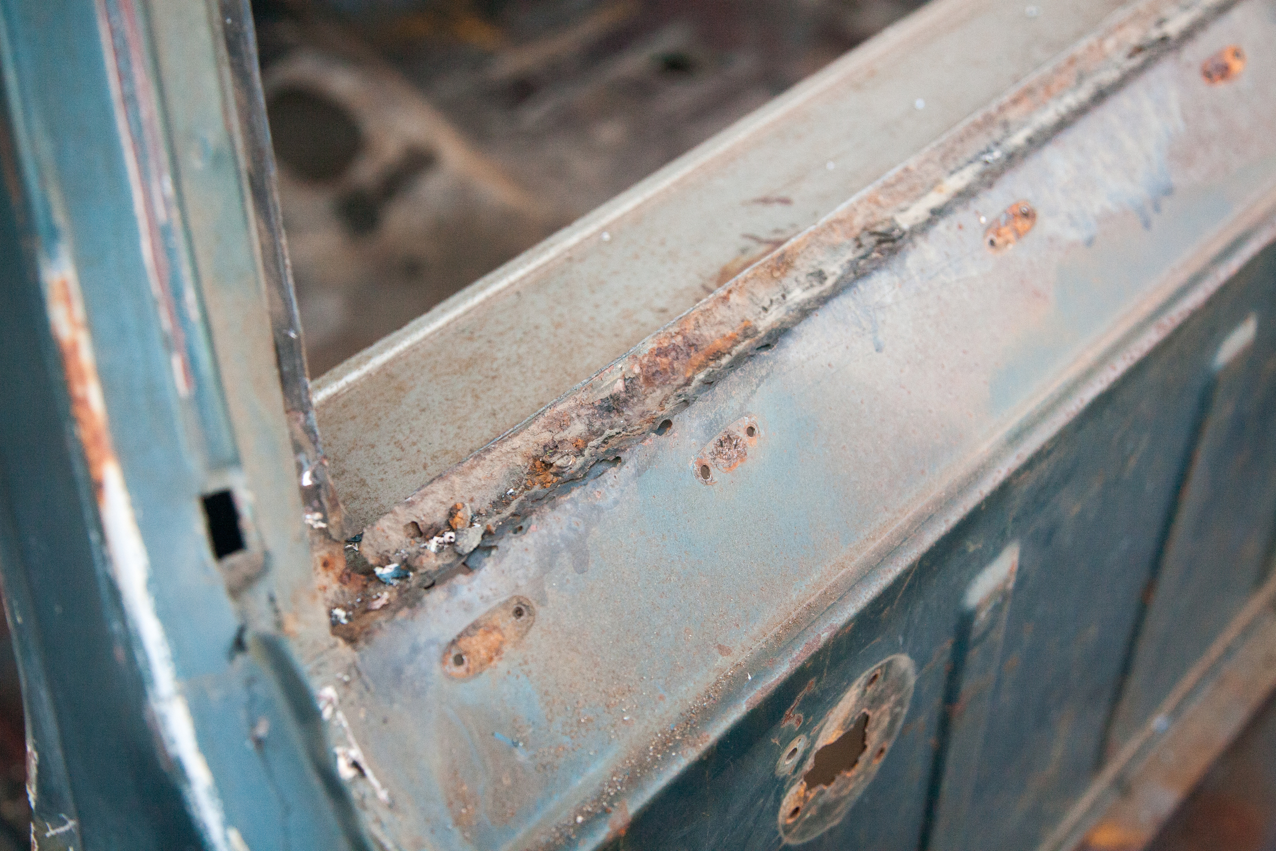 Rust in the typical areas is evident, like this back window area. Sandblastingwill uncover the full extent of the damage.