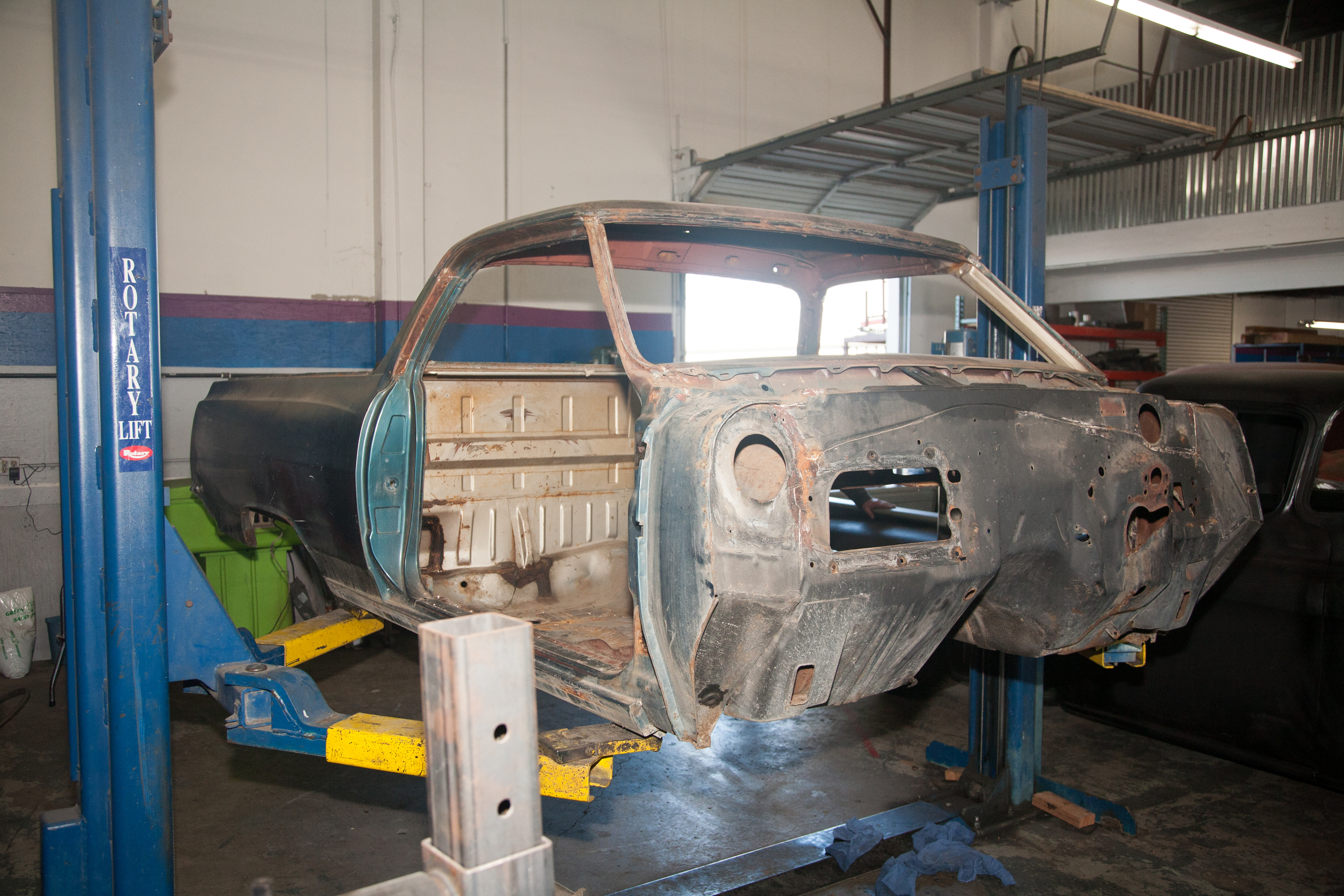 Once the body is completely stripped, it it removed from the chassis and put onto a rotisserie.