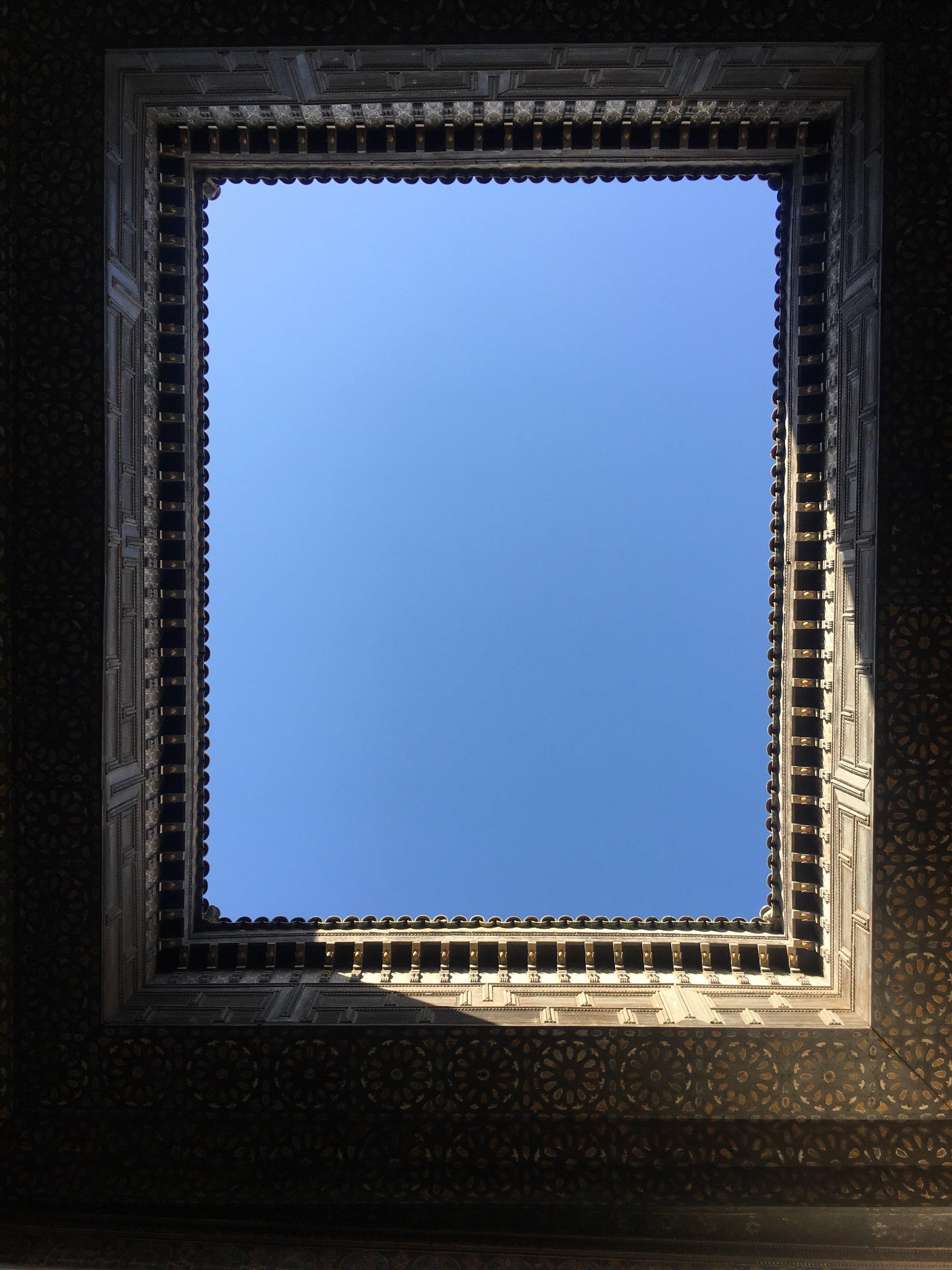 Look up at this open air courtyard at Riad de Tarabel.