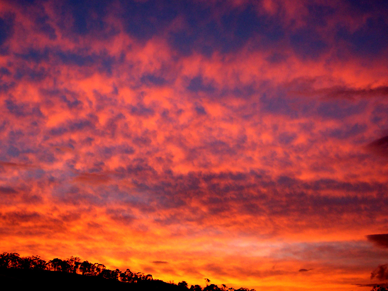 """Crimson Sunset"" -- from Wikimedia Commons."