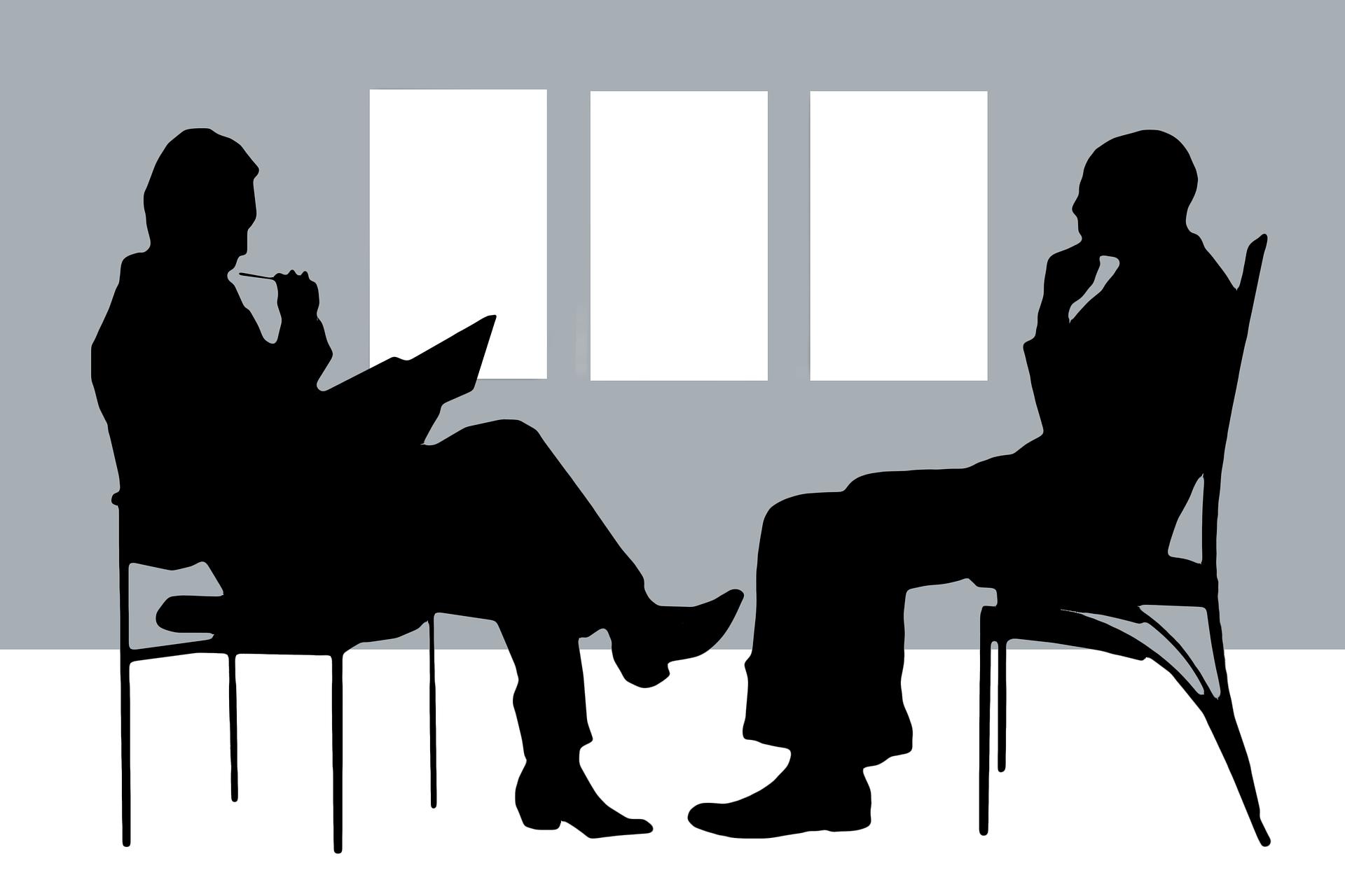 two people talking and debating.