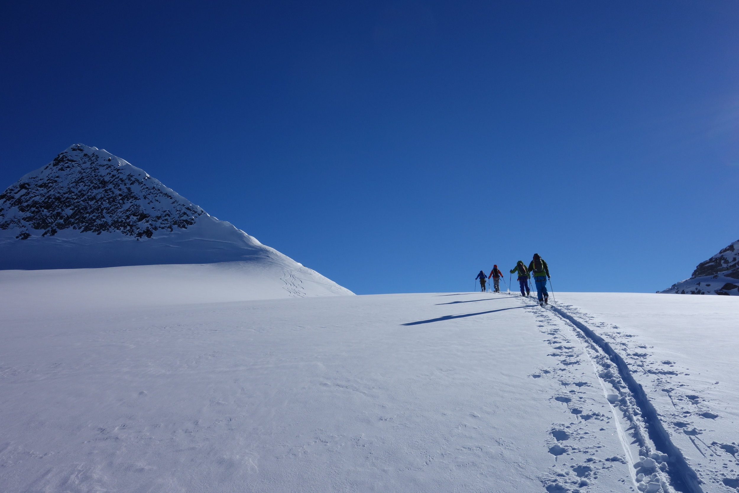 Candidates approach Sapphire Col on their AMGA Ski Mountaineering Guide exam, 2014.