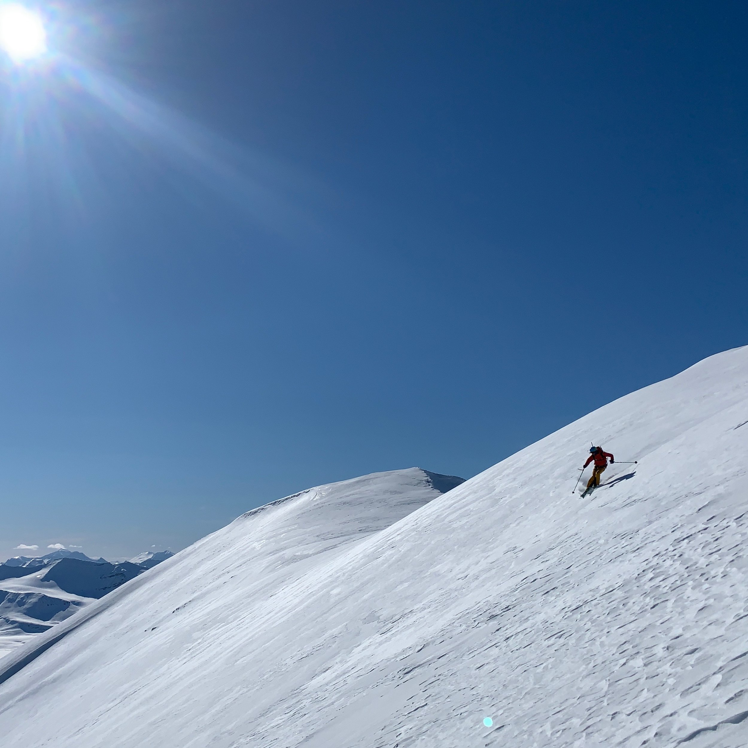 Enjoying forgiving guiding conditions: epic views, soft corn, and phenomenal skiing!
