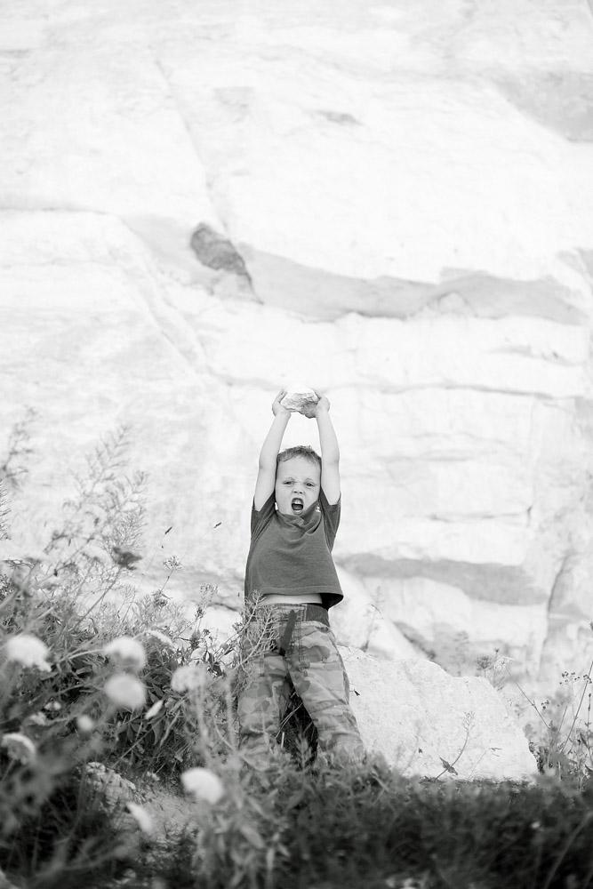 boy with rock