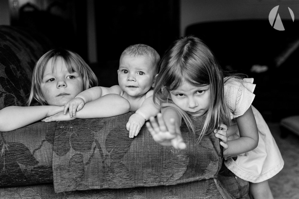 Sisters and baby brother at home