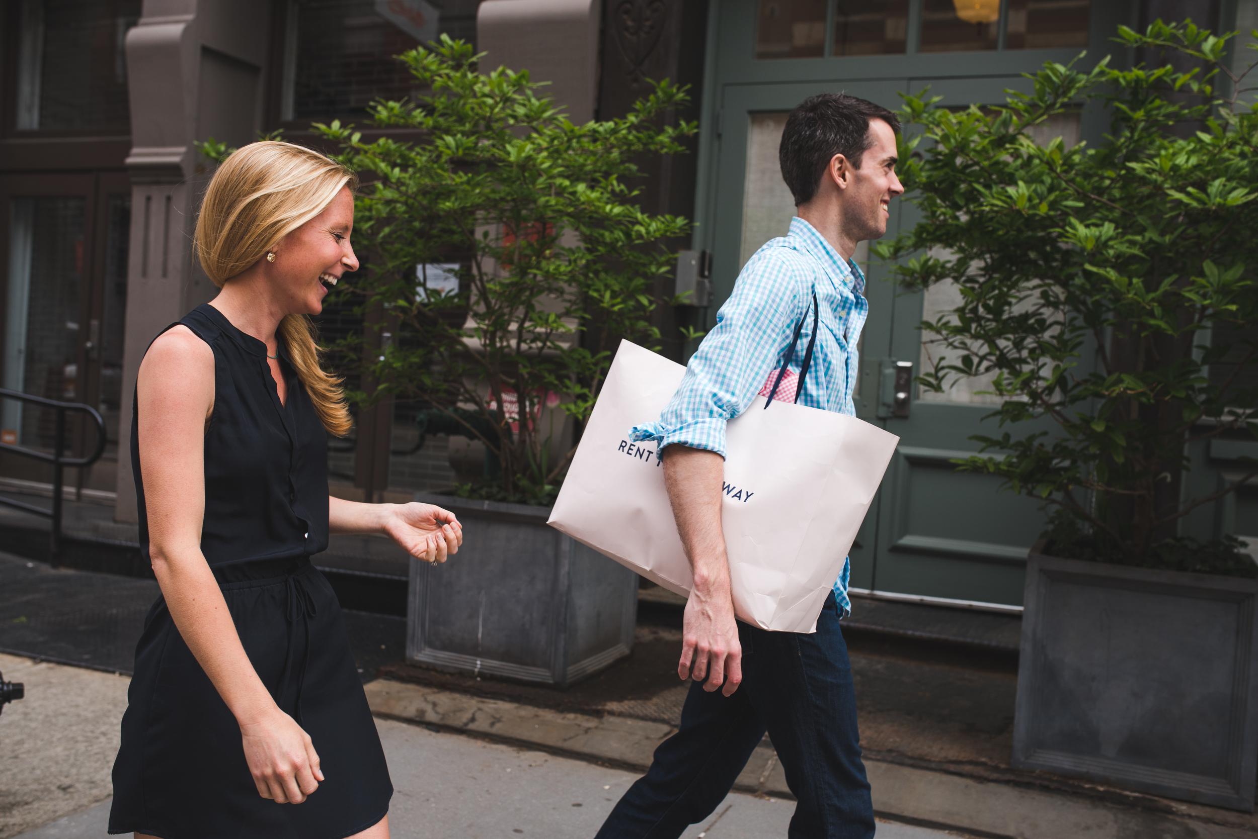 Feature husband caring her wife bag.JPG
