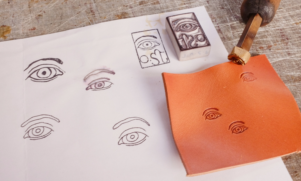 The original rubber stamp and the new engraving stamp with the Eye.