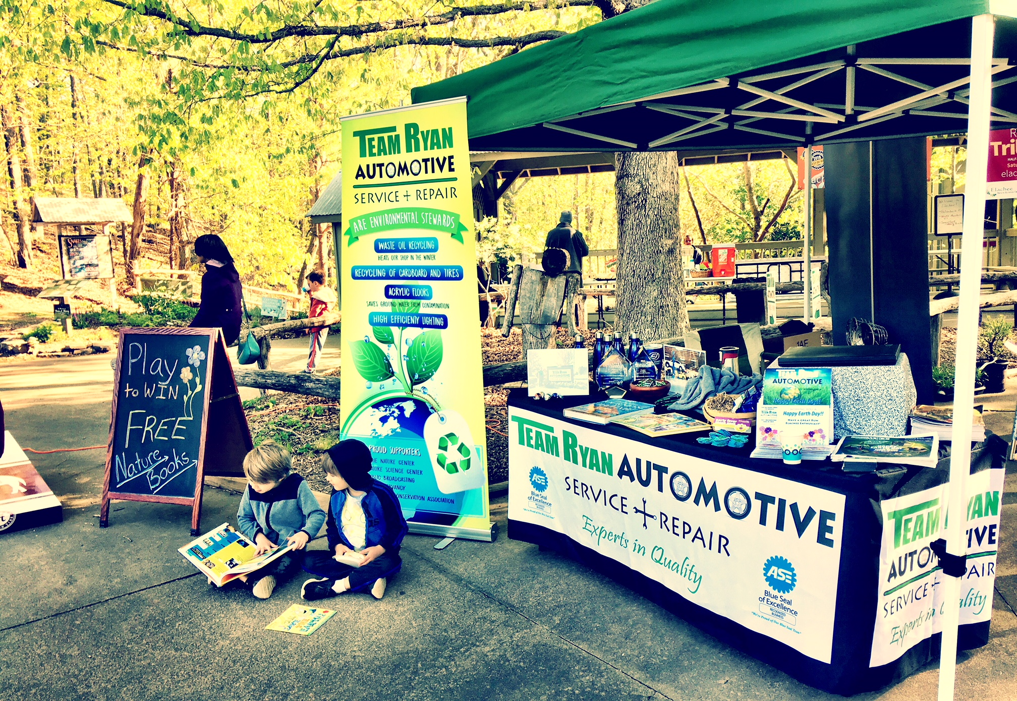 Team Ryan Automotive booth at Earth Day.jpg