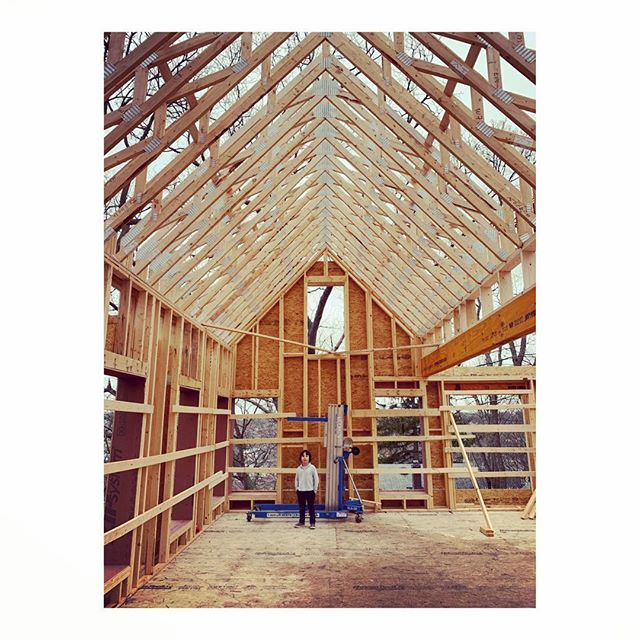 Small man under tall ceilings. Framing underway again at the Roslindale single family after a brief pause for truss delivery and slab pours. #gc #architecture #development #contractor #carpentry #keepcraftalive #passivehouse #2030 #carbonchallenge #cathedralceilings #trussme #trusses #placetailor #roslindale