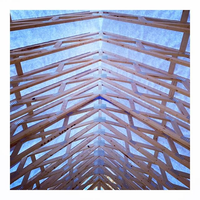 """Vapor open but air sealed roof detail with fir faux rafter tails. Truss cavity will get 24"""" of medium pack cellulose. We will apply T&G fir boards over the exposed part of the soffit and then sheath over the top of the 4x4s. 4x4s will remain as exposed tails. That gives a 4"""" vent cavity to the ridge, so while the truss assembly is air tight any vapor that passes through the membrane will easily vent out the ridge vent. This detail is very common in Europe, and we have been putting this detail on every gable roof we have done for the past 7 years. We should never have condensation issues with this assembly despite the thickness of the insulation. And ZERO spray or board foam. #longevity #airtight #airseal #vaporopen #cellulose #fir #carpentry #passivehouse #details #architecture #placetailor #2030 #foamfree #carbonchallenge @siga_north_america @huberwood #roofing #netzero"""