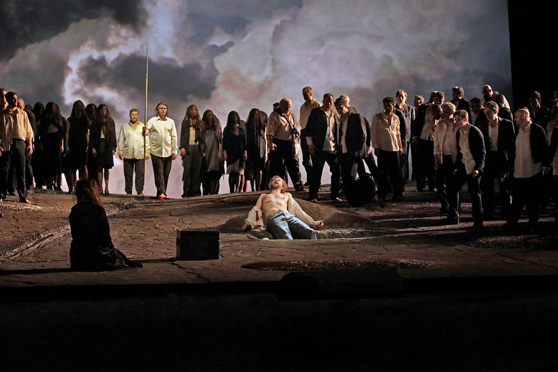 Parsifal returns to heal Amfortas, who lies wounded in the foreground
