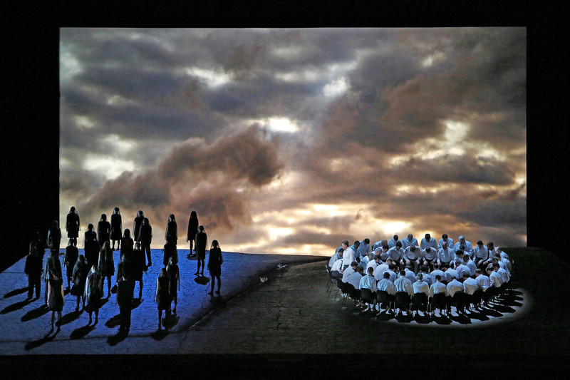 The women stand isolated to the left whilst the met pray on the right.  Parsifal  Act I