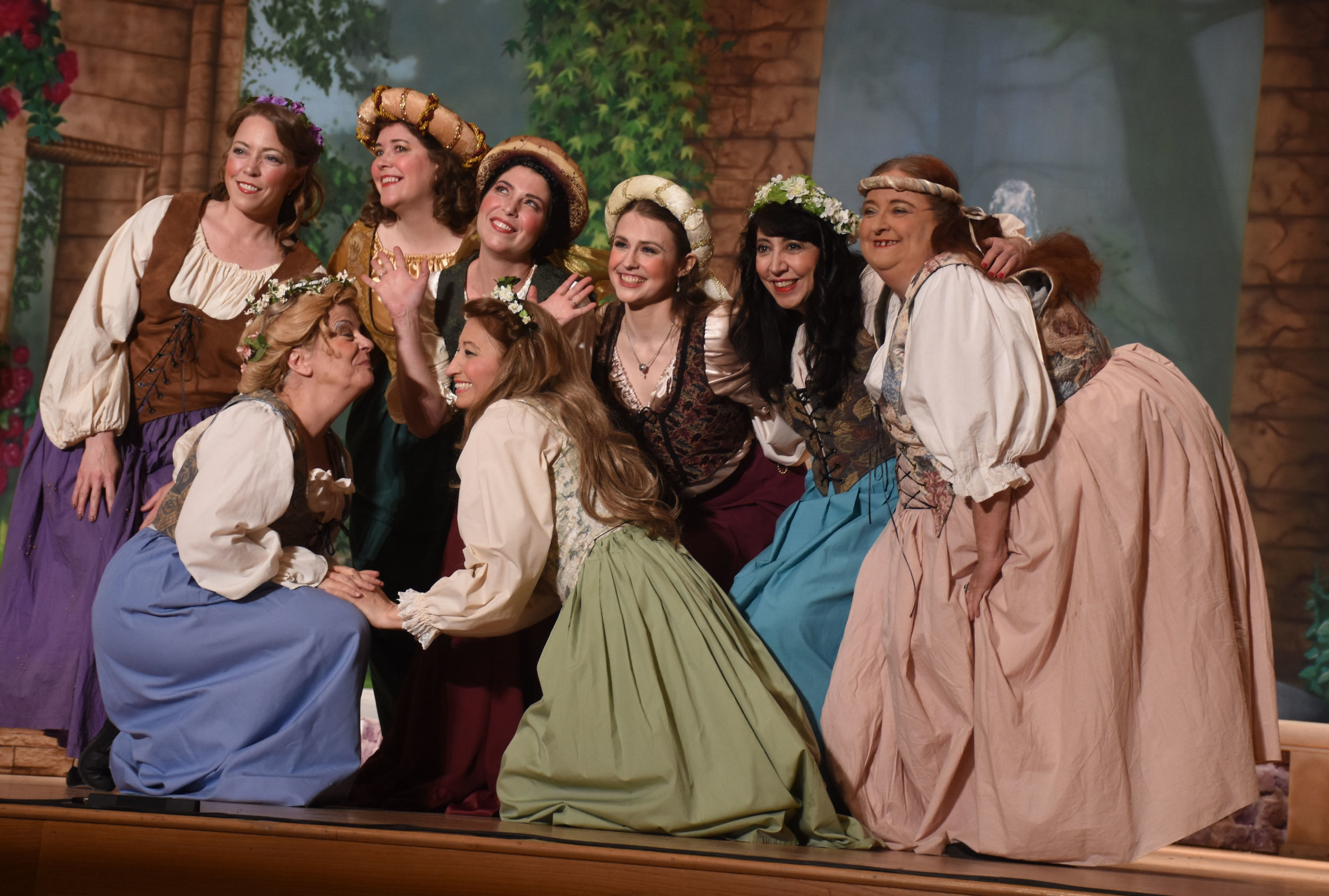 Wendy Falconer, Brett Kroeger, and Jennifer Wallace as the three little maids with other maiden attendants