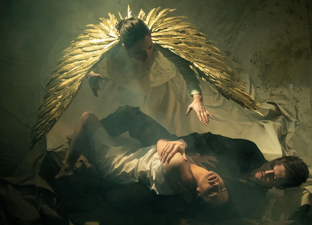 The Angel hovers over poor Tamara who is involved in at risk behavior with the Demon in Bard's production of    The Demon