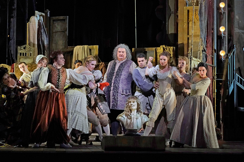 Backstage in Act I, Scene I: Ambrogio Maestri is Michonnet, surrounded by his troupe