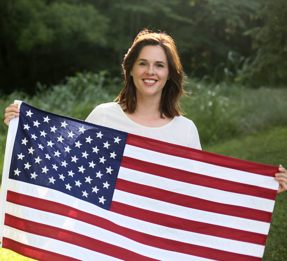 Jessica Quirk holding her handmade American Flag