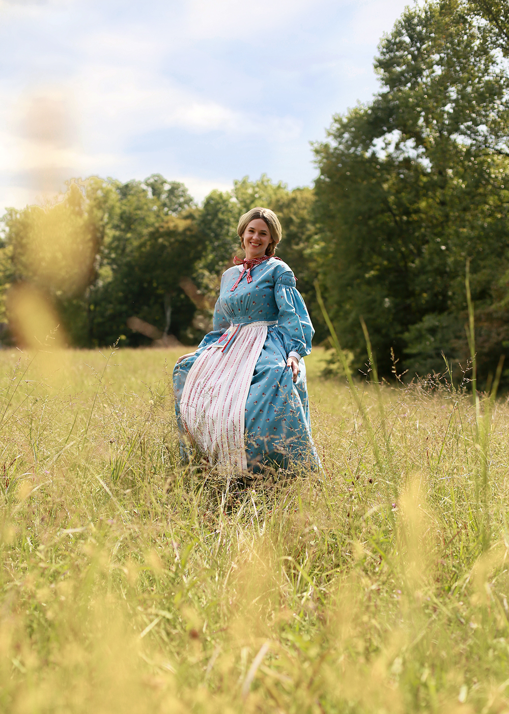 Historical AG Kirsten running in Field, custom 1854 dress by Jessica Quirk