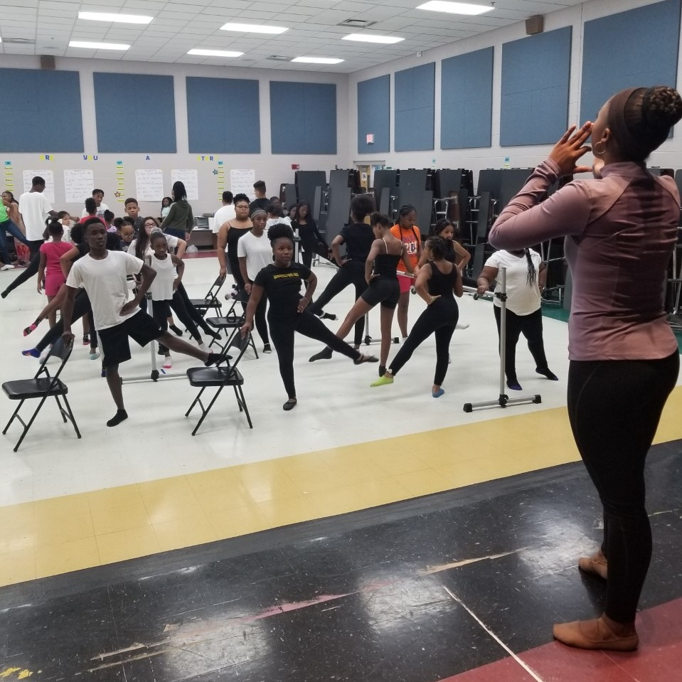 Imani teaching at Moves and Grooves.jpg